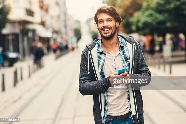 on the phone - young men stock pictures, royalty-free photos & images