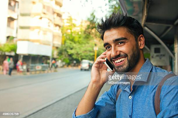 on the phone! - handsome people stock pictures, royalty-free photos & images