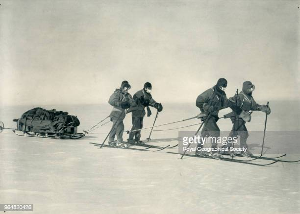 On the Polar Plateau Evans Oates Wilson Scott on skis and pulling a sledge Antarctica 1912 British Antarctic Expedition 19101913