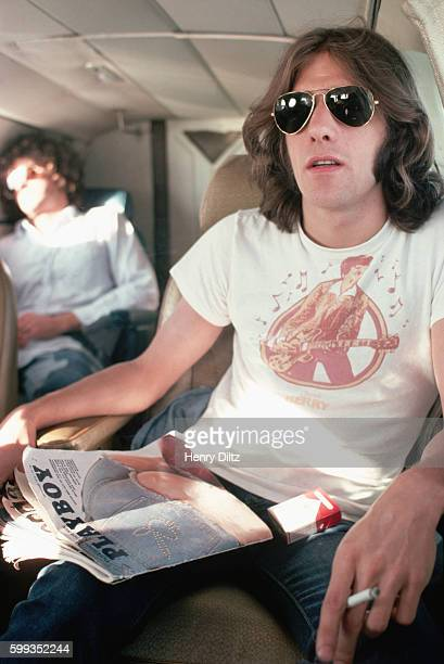 On the private jet to their next show The Eagles' Glenn Frey smokes a cigarette and reads Playboy magazine The Eagles were the most popular band of...