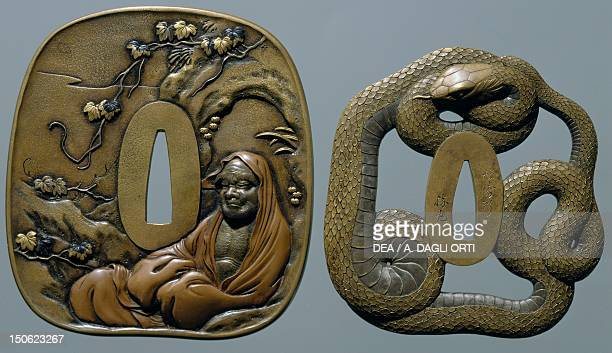 On the right brass tsuba engraved pierced and damascened depicting a snake coiled around itself left sentoku tsuba engraved and inlaid with copper...