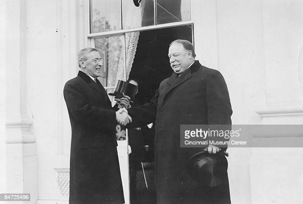On the right losing incumbent William Howard Taft congratulates incoming president Woodrow Wilson at the latter's inauguration in Washington DC 1913