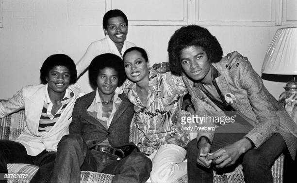 On the right Michael Jackson sits next to singer Diana Ross backstage in Chicago IL 1979 2 other Jackson brothers sit to Diana's side while her...