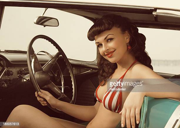 on the road again. - pin up girl stock-fotos und bilder