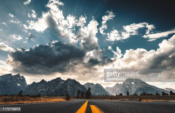 on the road at the teton national park - grand teton national park stock pictures, royalty-free photos & images