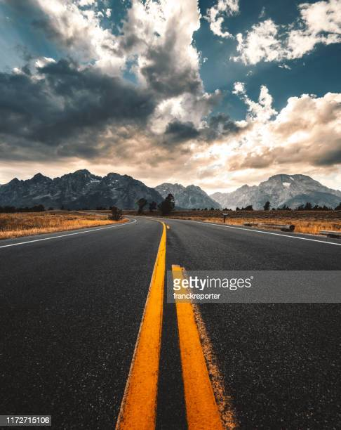 on the road at the teton national park - national landmark stock pictures, royalty-free photos & images