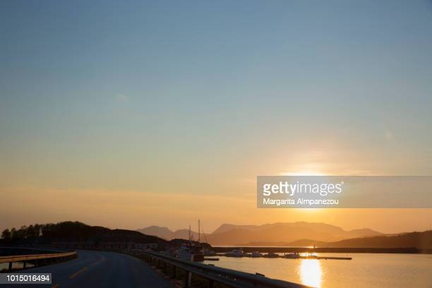 On the Road: Driving among the islands of Norway at sunset