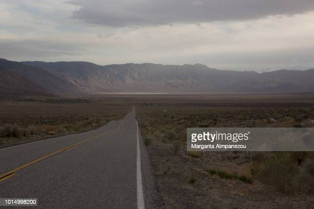 On the Road: Driving an empty road to the mountains in Sierra Nevada