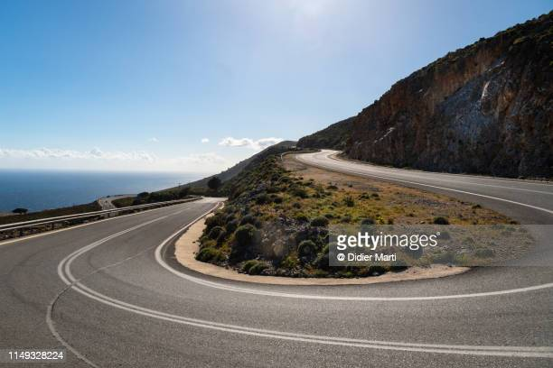 on the road in crete, greece - curve stock pictures, royalty-free photos & images