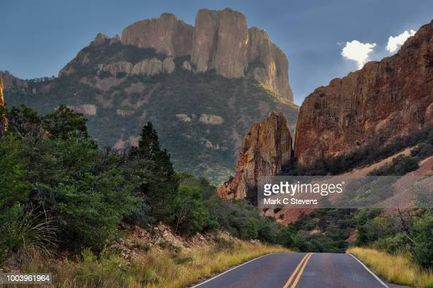 on the road in the mountains of big bend national park - chisos mountains stock pictures, royalty-free photos & images