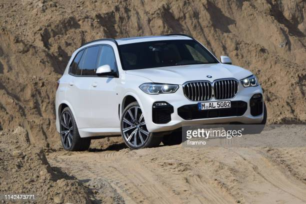 bmw x5 on the road - bmw stock pictures, royalty-free photos & images