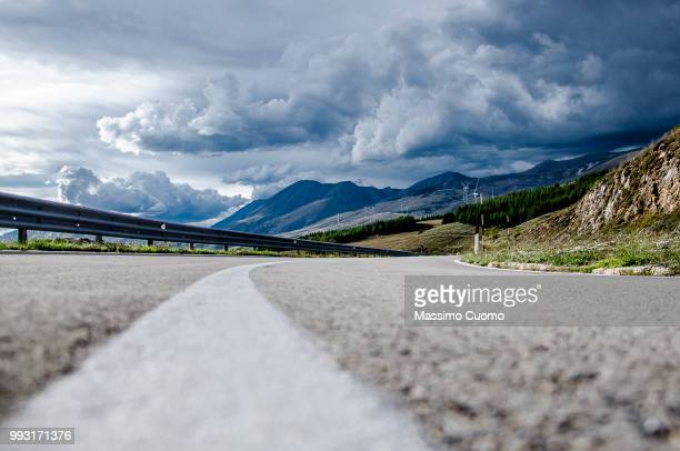 on the road ... - cuomo stock pictures, royalty-free photos & images