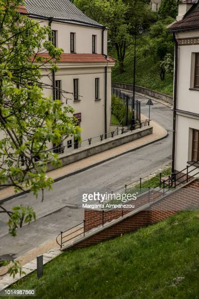 On the Road: Road passing through houses and green areas in Lublin