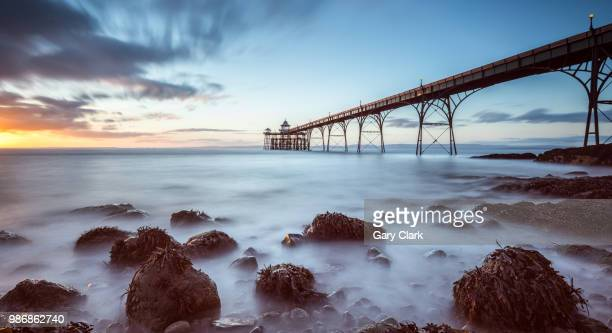 on the rocks! - clevedon pier stock pictures, royalty-free photos & images