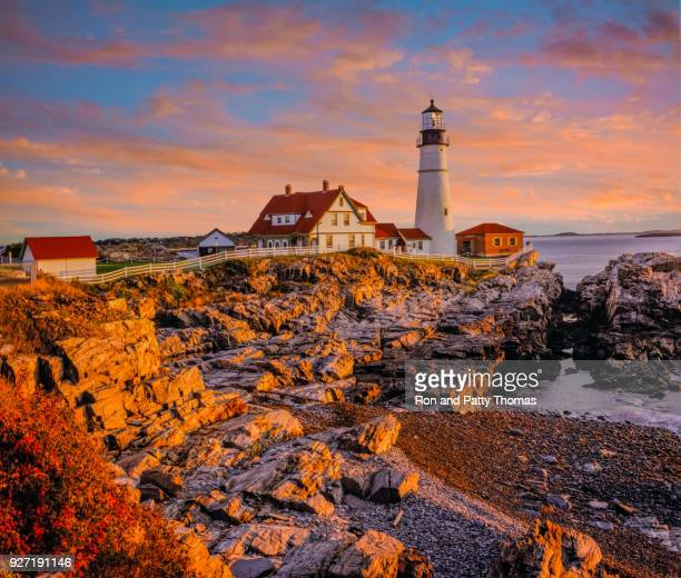 on the rocky coastline with portland head light, maine - maine stock pictures, royalty-free photos & images