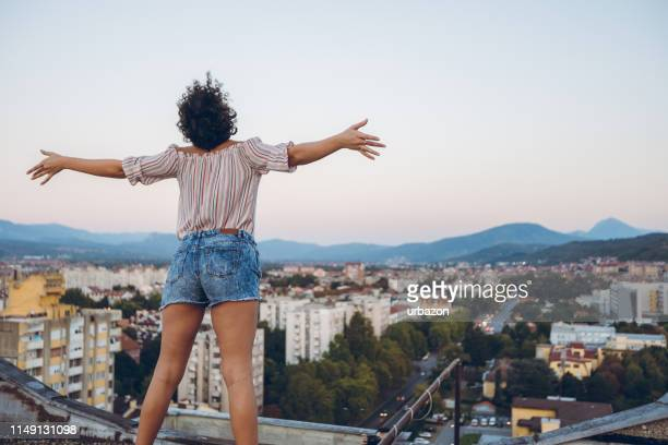 on the rooftop - spreading stock pictures, royalty-free photos & images