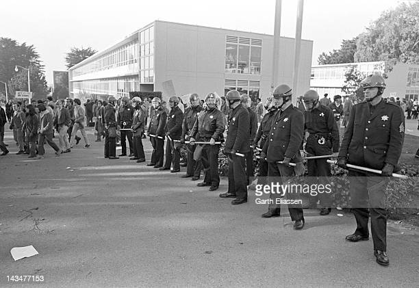 On the San Francisco State College campus members from the San Francisco Police Department's Tactical Squad stand with nightsticks out as the...