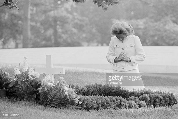 On the second anniversary of his death Ethel Kennedy visits Arlington National Cemetery in the early morning hours and prays at the grave of the late...
