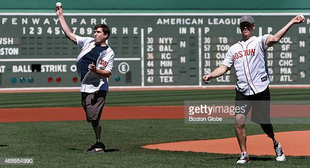 On the second anniversary of the Boston Marathon bombings survivors Jeff Bauman left and Patrick Downes right threw out ceremonial first pitches...
