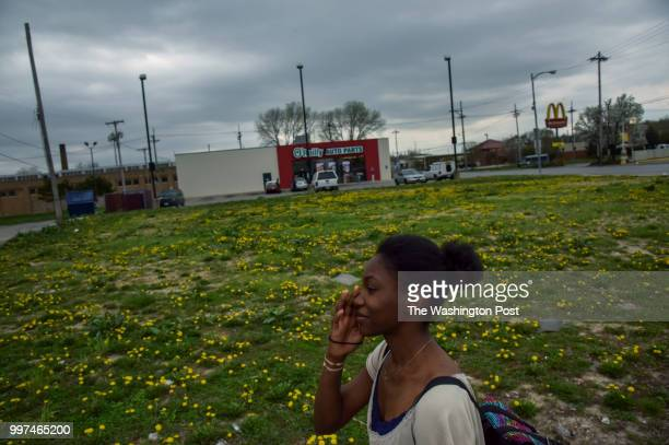 On the second day of a weeklong job training program Angelica Dunn walks past one of many longtime vacant lots on her more than three mile trek from...