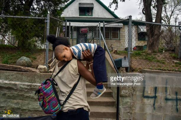 On the second day of a weeklong job training program Angelica Dunn arrives home in North Omaha with her son ThomasJohnathan CzarnikowDunncq after...