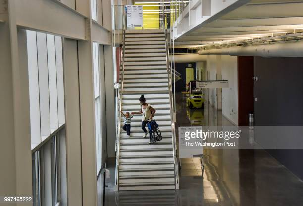 On the second day of a weeklong job training program Angelica Dunn heads toward the campus exit and toward home with her son ThomasJohnathan...