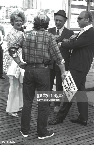 On the set of British film 'Carry On Girls' Sid James is pictured with Joan Sims director James Thomas and producer Peter Rogers