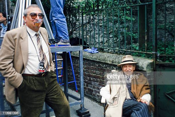 On the set of Le Cri du Hibou in France in May, 1987-French director Claude Chabrol with actor Louis Ducreux on the set of Une Affaire de Femmes.