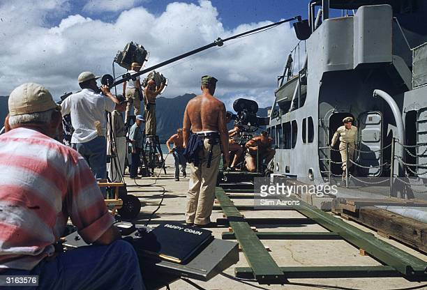 On the set of Mister Roberts directed by John Ford and Mervyn LeRoy Star lead Henry Fonda as Lt Doug Roberts is coming up on deck