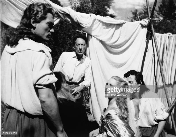 On the set of the film 'La Belle et la Bete' directed by Jean Cocteau France 1946 From left French actor Jean Marais director Cocteau French actress...