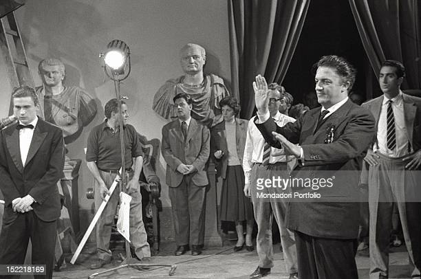 On the set of the movie 'La Dolce Vita' the Italian director Federico Fellini gives some information to the actors around him technicians and members...
