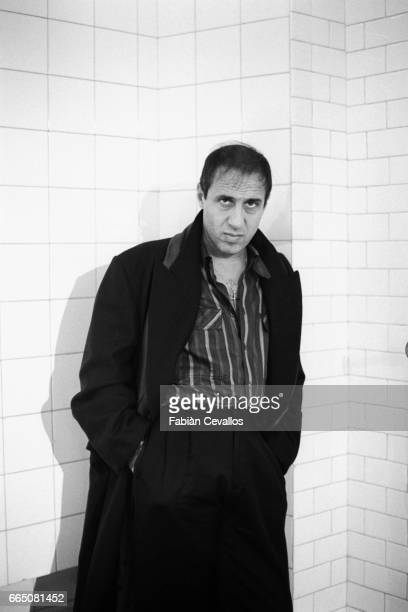 On the set of the movie 'Lui e peggio di me' directed by Enrico Oldoini actor and singer Adriano Celentano wearing a dark suit and a striped shirt...