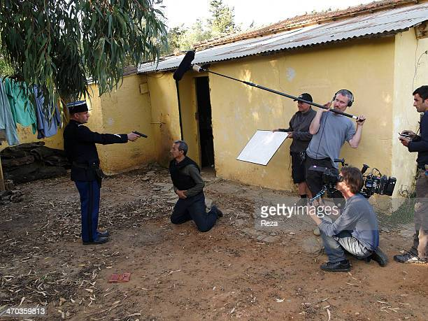 On the set of Zabana a movie by Algerian director Said OuldKhelifa produced by Yacine Laloui on May 14 2011 A French policeman threatens a...