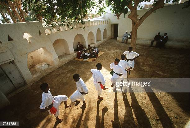 On the Slaves Square a site of a former slave market a dance troupe performs a traditional dance April 2000 in Ghadames Libya