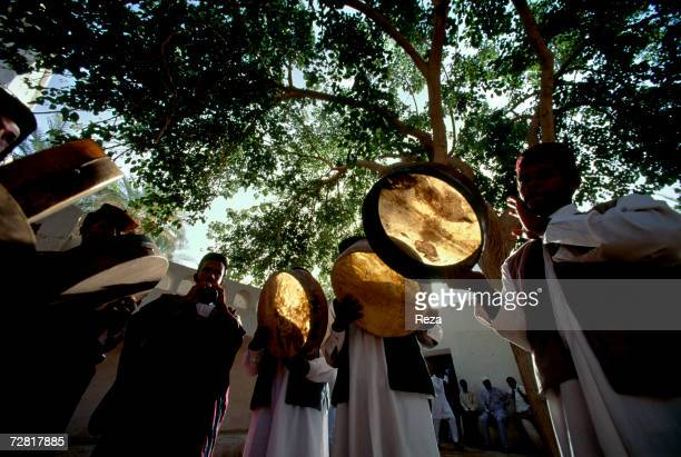 On the Slaves Square a site of a former slave market a group of musicians play the drums April 2000 in Ghadames Libya
