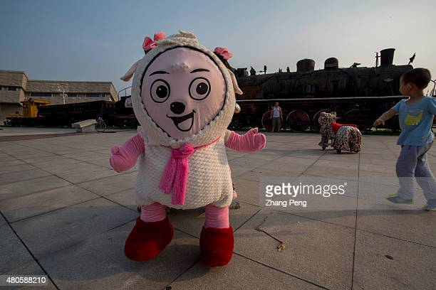 On the square of the Haizhou coal mine heritage park an electric toy bike decorated as a famous Chinese cartoon character 'Xiyangyang' stops in front...