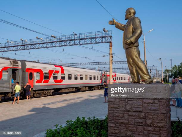 On the station platform at Belogorsk Amur Oblas a golden statue of Lenin gestures towards the Trans Siberian The TransSiberian Railway from...