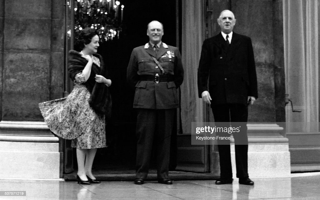 On the steps of the Elysee palace during an official visit, Yvonne de Gaulle, King Olav V and General de Gaulle, on September 26, 1962 in Paris, France.