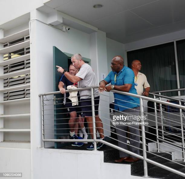 On the steps outside the England dressingroom in the Sir Garfield Sobers pavilion assistant coach Paul Farbrace remonstrates with an England...