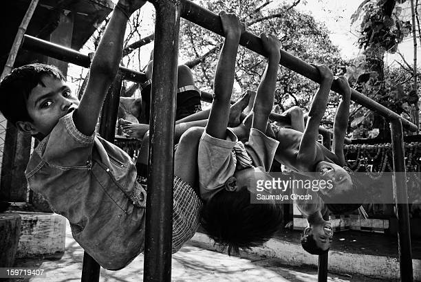 CONTENT] On the streets of Kolkata a few boys are hanging on the iron bars and enjoying themselves