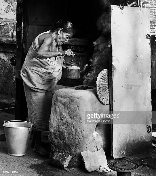 CONTENT] On the streets of Kolkata an old woman a roadside shop owner is preparing early morning tea for the customers