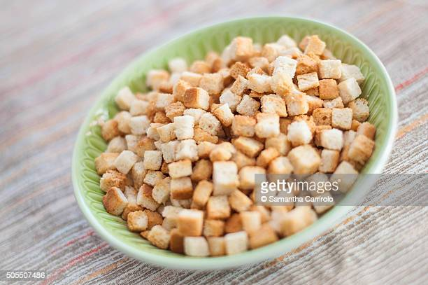 on the table _ croutons - crouton stock photos and pictures