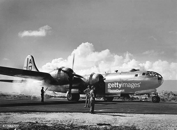 On the tarmac the grounds crew stand by while a B29 bomber's engine starts up Saipan Northern Mariana Islands January 15 1945