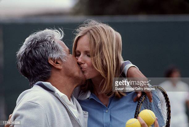 On the tennis court at La Costa Resort Spa American model and actress Cheryl Tiegs kisses professional tennis player Pancho Gonzales Carlsbad...