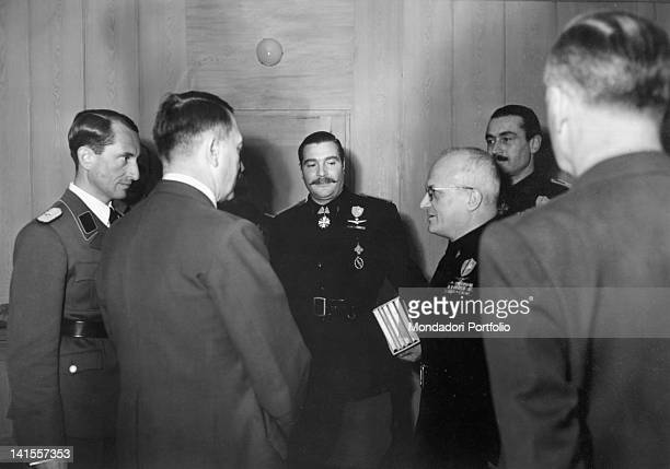 On the tenth anniversary of the Nazi seizure of power in Germany the Chancellor of the Third Reich Adolf Hitler receiving the deputy secretary of the...