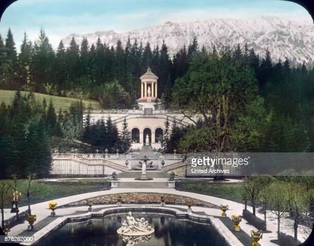 On the terrace of Linderhof castle at Ettal with view to the mountains in Bavaria