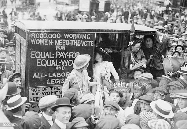 On the Top of a double Decker Bus Washington Suffragettes make their Cause known astride a city trolley