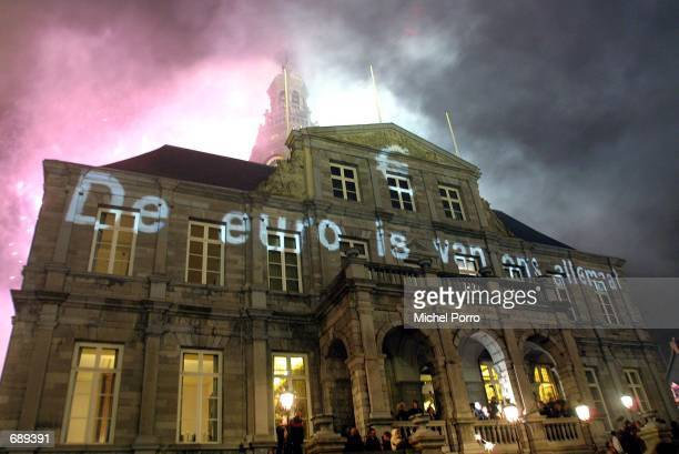 On the town hall of Maastricht is projected the text 'The Euro belongs to us all' at a Euro party January 1 2002 in Maastricht The Netherlands The...
