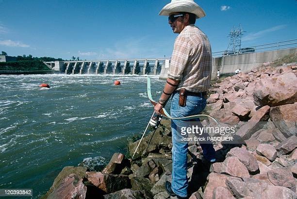 On the tracks of Lewis and Clark in United States in 1997 Randy fish with a bow at Gavin's dam in Nebraska