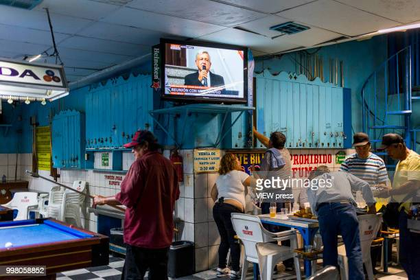 MEXICALI MEXICO July 10 On the TV screen Andres Manuel Lopez Obrador talks about the visit of Mike Pompeo to Mexico while people play pool in a Bar...